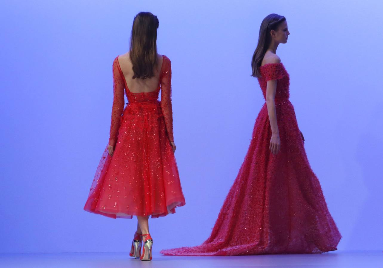 Models present creations by Lebanese designer Elie Saab as part of his Haute Couture Spring/Summer 2014 fashion collection in Paris