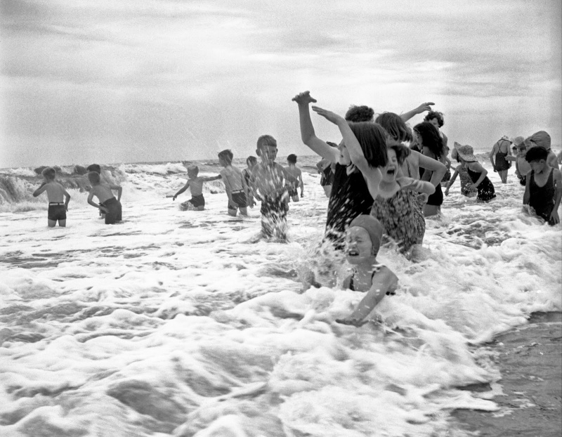 Children from the Otaki Health Camp playing in the sea, 1945